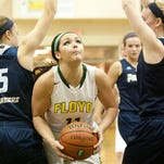 Floyd Central Lady Highlanders forward Madison Kaiser drives between Providence Lady Pioneers guard Olivia Jenkins, left, and Lady Pioneers forward Claire Rauck, right. 29 January 2015