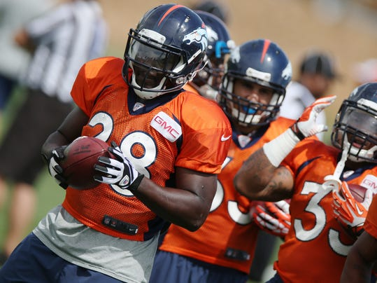 Denver Broncos running back Montee Ball takes part in drills during the morning session at the team's NFL training camp at Broncos headquarters in Englewood, Colo., on Friday, Aug. 1, 2014. (AP Photo/David Zalubowski)