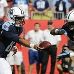 Titans quarterback Marcus Mariota (8) hands the ball to running back Bishop Sankey (20) on Sunday against Tampa Bay. Mariota's play-action skills were a key part of the Titans' 42-14 win.
