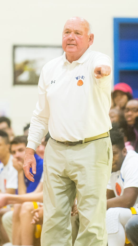 Wicomico High head coach Butch Waller moves his team against Stephen Decatur in the Waller Dome at Wicomico High on Tuesday, Jan 19.