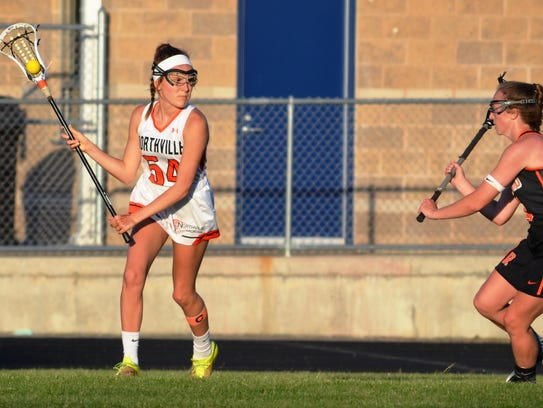 Northville's Emma Dietrich (left) looks for an opening
