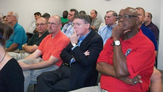 Members of the Springfield Board of Mayor and Aldermen listen intently to ways the school board plans to repair city schools on July 20, 2011.