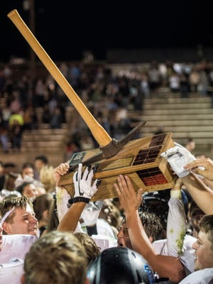 Canyon View High School celebrates winning the pickaxe against Cedar High School in a Spectrum file photo.
