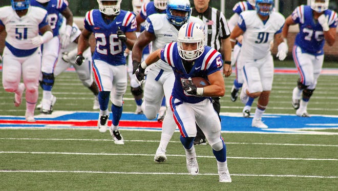 Louisiana Tech wide receiver Trent Taylor runs up the field in Saturday's win over Middle Tennessee.