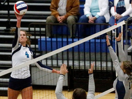Siegel's Makenzie Jordan (4) hits the ball over the net during the Class AAA sectional game against Walker Valley, on Thursday, Oct. 12, 2017, at Siegel.