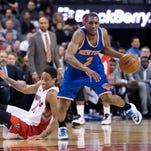 Langston Galloway of the Knicks drives past the Toronto Raptors' DeMar DeRozan.