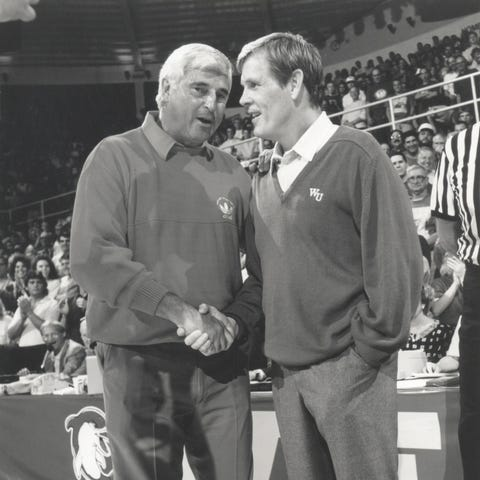 Competing coaches Pete Bell (Nick Nolte, right )...
