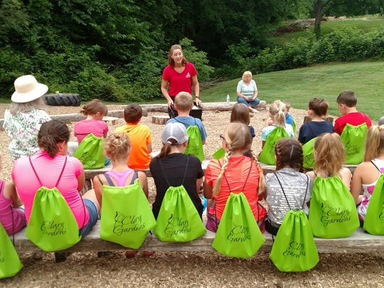 Tammi Rogers of Coshocton County Litter Prevention teaches junior master gardeners about worms and composting at Clary Gardens in this Tribune file photo. Rogers said there is an uptick in recycling as more people are staying home during the coronavirus pandemic. She is exploring the idea of reading children's books on littering she has and doing some other tutorials on the recycling and litter prevention office's Facebook page.
