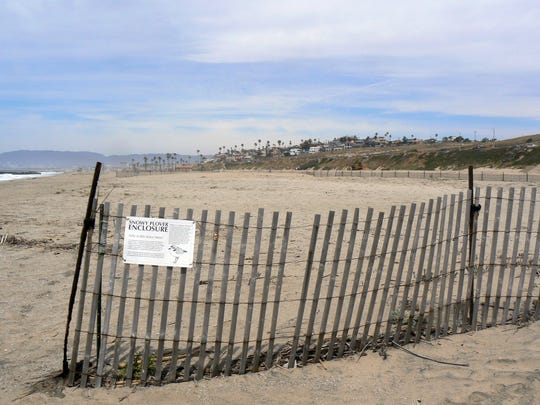 Fencing and signage at Dockweiler State Beach