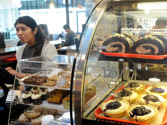 Verenice Zuniga serves customers at the Scratch Sandwich Counter in The Annex at The Collection at RiverPark in Oxnard.