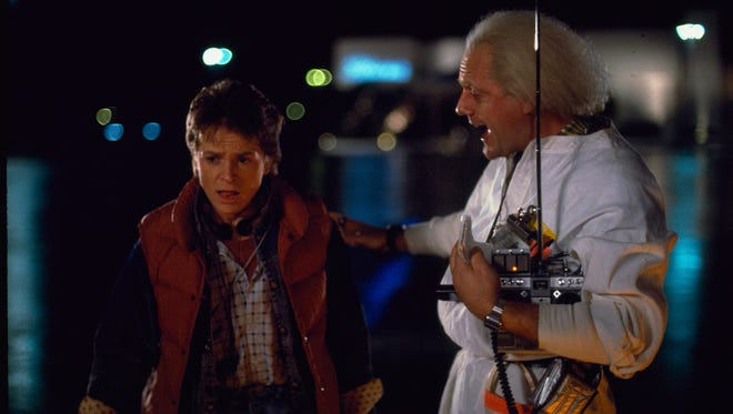 """Marty McFly (Michael J. Fox) and Dr. Emmett """"Doc"""" Brown (Christopher Lloyd) in 1985's """"Back to the Future."""""""