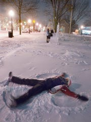 Christina Riga makes snow angels in Plymouth's Kellogg Park during a snowstorm in 2011. Christina, her sister, Samantha Riga, and friend Elizabeth Rodriguez, attended Ladywood High School in Livonia, which had called a snow day.