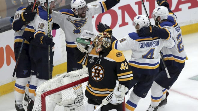 The St. Louis Blues' Zach Sanford (12) celebrates his third-period goal with teammates as Bruins goaltender Tuukka Rask takes a drink. St. Louis never relented in pursuit of its first Stanley Cup, outgunning Boston, 4-1, at TD Garden. Friday is the one-year anniversary of that game.