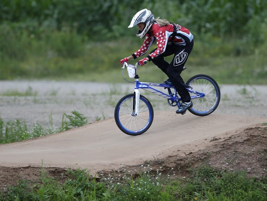 Emma DeBruin, 13, works her way through the course