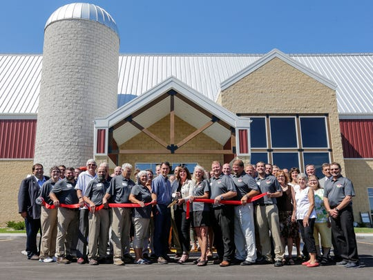 Farm Wisconsin Discovery Center board of directors cut the ribbon with special guest Governor Scott Walker, center, in front of the main entrance during a preview event Monday, July 16, 2018, in Manitowoc, Wis. Josh Clark/USA TODAY NETWORK-Wisconsin