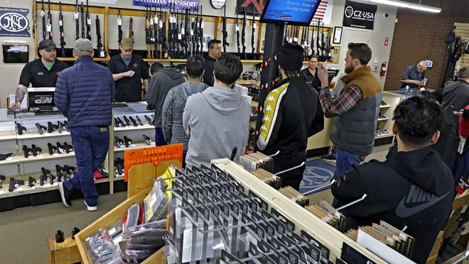 Customers wait in line at L.E.P.D. Firearms and Range on Bethel Road in March.