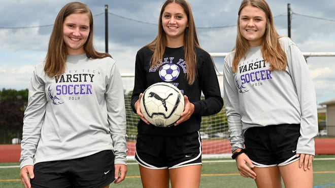 Blackstone Valley Tech soccer player Emma Ballard (center) with her twin sister Kyra (left) and teammate Hannah Parath.