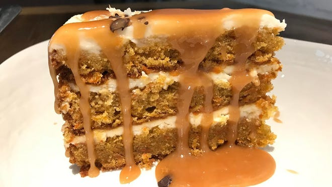 One of many desserts available to celebrate International Women's Day is this carrot cake with warm Carmello, Murray salt and shaved dark chocolate from Dorona, a modern Italian stekhouse in Naples.