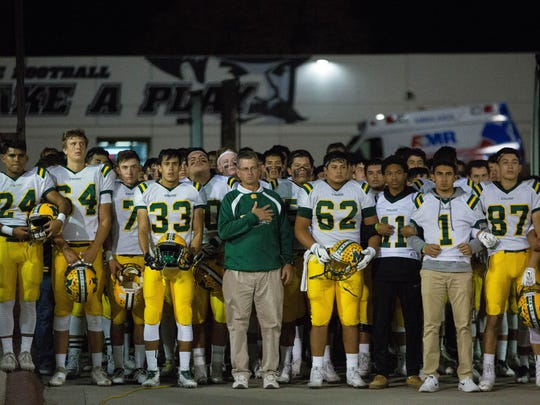 The Mayfield High School Trojans prepare to walk out onto the field of Aggie Memorial Stadium, Friday November 3, 2017, before their game against Las Cruces High School Bulldawgs.