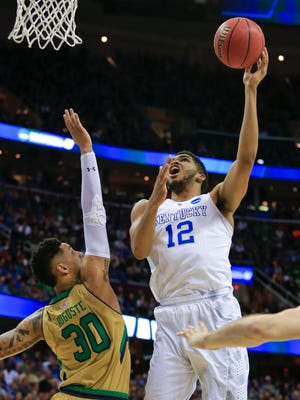 Kentucky's Karl-Anthony Towns had 25 points and five rebounds in the Elite Eight game against Notre Dame Saturday at Quicken Loans Arena in Cleveland. The Wildcats survived the Irish 68-66. The Wildcats go on to the Final Four in Indianapolis. March 28, 2015. By Matt Stone, The C-J