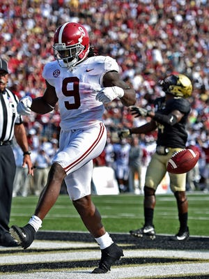 Alabama running back Bo Scarbrough (9) scrolls into the end zone during the 1st half of an NCAA football game at Vanderbilt Stadium Saturday, Sept. 23, 2017 in Nashville, Tenn.