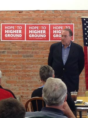 Mike Huckabee answers a question from one of the estimated 45 people who turned out for his event in Greenfield, Ia.