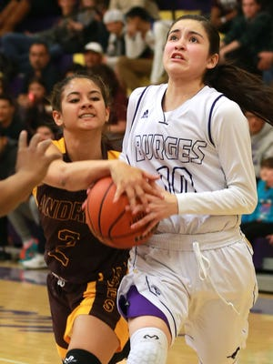 Burges' Natalie Sanchez, right, has verbally committed to play college basketball at Stephen F. Austin next season.