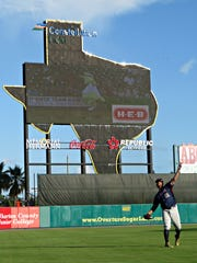 Somerset Patriots outfielder Aharon Eggleston makes a throw in front of the Constellation Field scoreboard in Sugar Land, Texas, where the team was playing against the Skeeters.