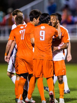 Clemson men's soccer players rally around senior Alex Happi in celebration after he scored the game-winning goal in Clemson's ACC semifinal game against Boston College on Wednesday in Clemson.
