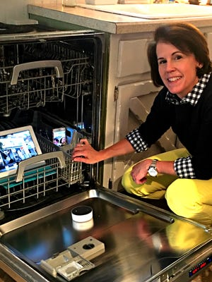 Brooke Fedigan checks out her smart appliances.