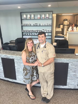 Julie and Rob Tomsett stand in the lobby of GracePointe Healthcare, 1311 West Main St. in Franklin. The couple completely renovated the circa 1958 medical building, which was the office of Dr. Joe Willoughby for 55 years.