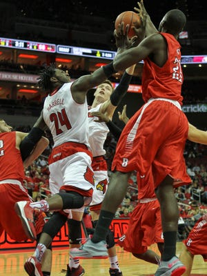 Louisville's Montrezl Harrell and Matz Stockman, center, battles Barry's Jevoni Robinson for the ball in the second half during the Cards' 91-71 win over Barry University Saturday afternoon at the KFC Yum! Center.  Nov.1, 2014 By Matt Stone/The C-J