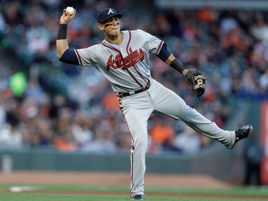Atlanta Braves' Rio Ruiz prepares a throw to first base in the first inning of a baseball game against the San Francisco Giants, Friday, May 26, 2017, in San Francisco. Giants' Eduardo Nunez was safe at first base on the play. (AP Photo/Ben Margot)