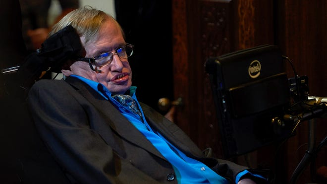British scientist Stephen Hawking attends a press conference in London on July 20, 2015, where he and Russian entrepreneur and co-founder of the Breakthrough Prize, Yuri Milner, announced the launch of Breakthrough Initiative, a new project to attempt to detect life in the Cosmos.