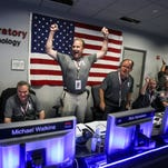 From left to right: Geoffrey Yoder, Michael Watkins, Rick Nybakken, Richard Cook and Jan Chodas celebrate in Mission Control at NASA's Jet Propulsion Laboratory as the solar-powered Juno spacecraft goes into orbit around Jupiter on July 4.