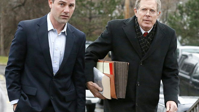 Murder suspect Thomas Clayton, left, walks with his lawyer Ray Schlather to Steuben County Court on Dec. 17, 2015.