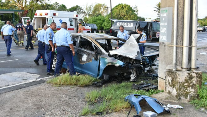 Emergency personnel respond to an auto crash that claimed the life of male driver on Route 10 in Mangilao on Tuesday, Oct. 13. The man died after the vehicle he was driving slammed into a concrete utility pole near the Department of Public Health and Social Services in Mangilao.