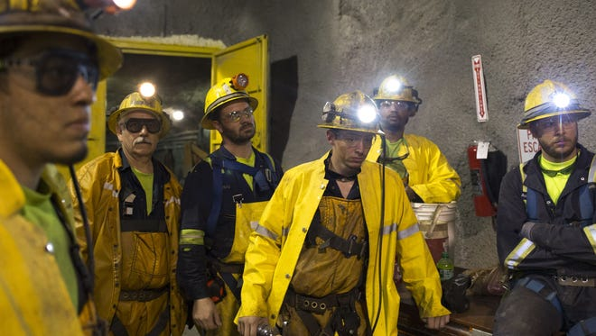 "Underground miners are shown in the ""never sweat tunnel,"" 1,200 feet below the surface at the Resolution Copper Mine."