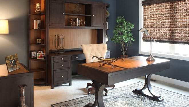 A computer credenza and coordinating desk bring order and comfort to a sophisticated design.