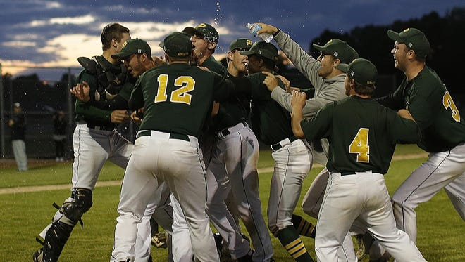 Green Bay Preble pitcher Caleb Schoenholz, second from left, is mobbed by his teammates after throwing a no-hitter against Green Bay West/East in Tuesday's WIAA Division 1 sectional final at Bay Port.