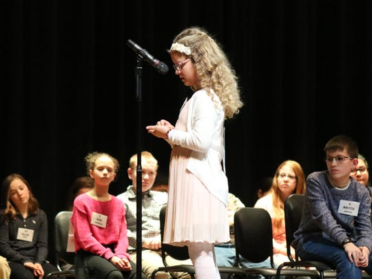 Makenna Lucas spells out a word on her way to earning second place at the Ottawa County Spelling Bee.