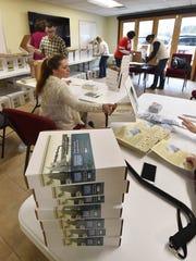 Volunteers assemble Door County Exploration Kits geared