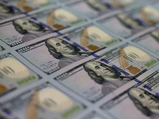 U.S. $100 bills at the Bureau of Engraving and Printing.