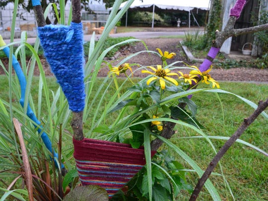 Painted and yarn-wrapped sticks are crafty, affordable