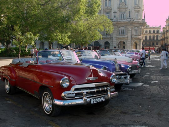 This row of vintage cars is a taxi stand in Havana