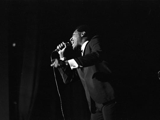 Otis Redding performs on stage during a concert at