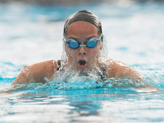 Lely's Audrey Delcompare, shown here swimming the breaststroke leg of the 200-yard IM during last year's 2A state meet, had a pair of top-three finishes in the Class 2A-Region 4 meet at the FGCU Aquatic Center on Saturday.