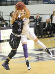 Stephen F. Austin's Taylor Ross, left, steals the ball away from ACU's Alexis Mason in the second half. SFA beat the Wildcats 70-61 on Thursday, Jan. 12, 2017 in a Southland Conference game at Moody Coliseum.