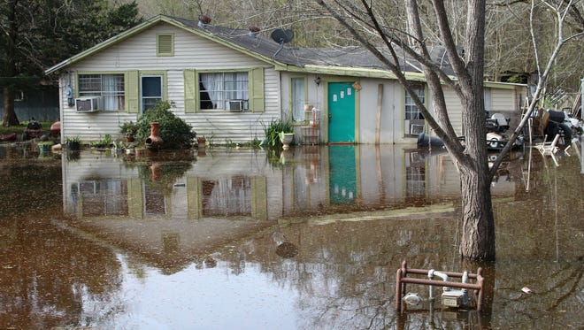 Levi Reed's home off of Louisiana 15 in Monroe remains flooded Wednesday.