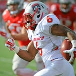 New Mexico running back Jhurell Pressley runs for a touchdown during the Lobos' 31-28 win Nov. 1 at UNLV.